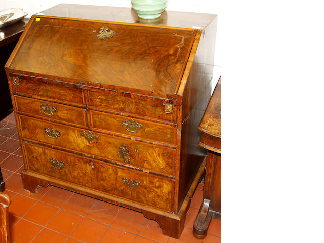 A walnut veneered bureau,