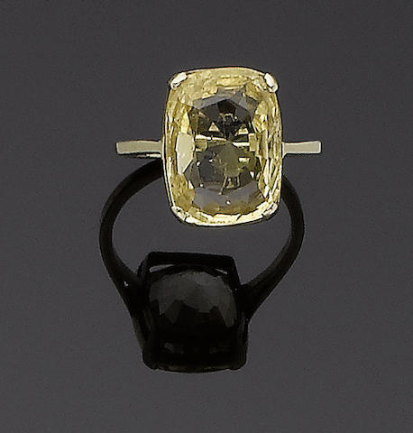 A yellow sapphire single-stone ring