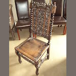 A Victorian carved oak side chair