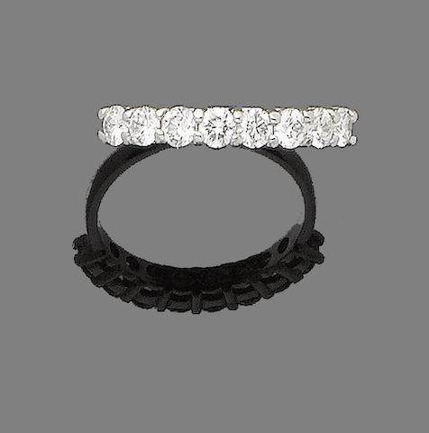 A diamond half-hoop ring