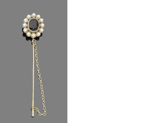 A sapphire and cultured pearl stick pin