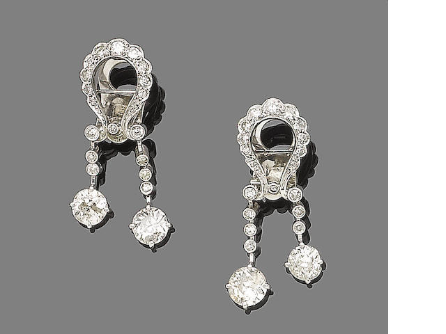 A pair of diamond pendent earrings