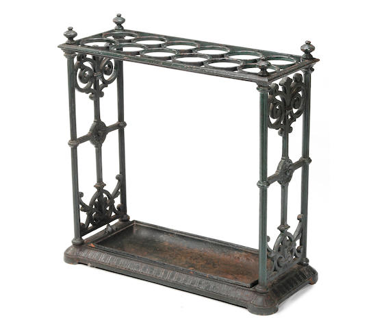 A Victorian cast iron umbrella and stick stand, last quarter 19th century, probably by Coalbrookdale The underside of the base stamped with an indistinct Registration lozenge, and 'No. 330925'; the underside of the drip tray stamped 'No. 250'