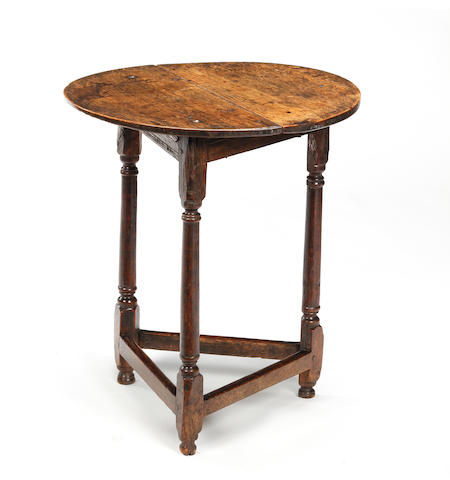 An early 18th century oak cricket table