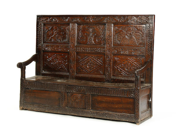 An oak high-back box settle Incorporating 17th century timbers