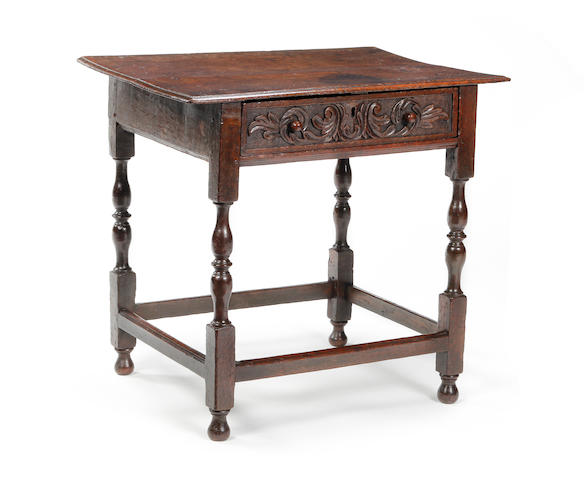 A small early 18th century oak side table
