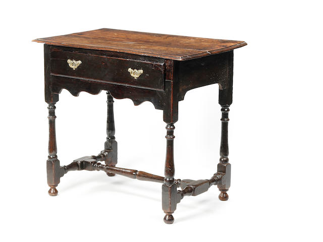 An early 18th century oak side table