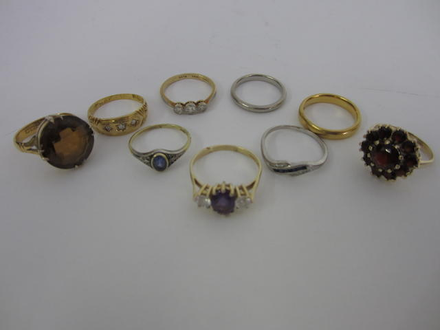 A Victorian 18ct gold and three stone diamond ring (9)