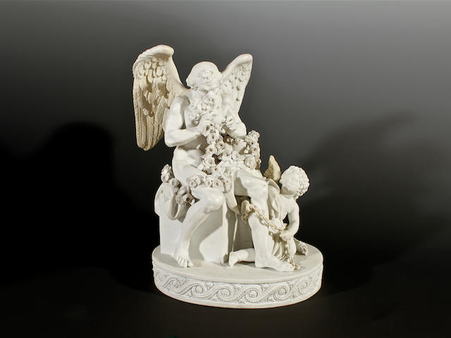 A Marcolini Meissen biscuit figure of Cupid with Old Father Time, late 18th century