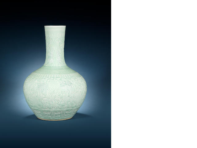 A carved celadon-glazed globular vase 19th century