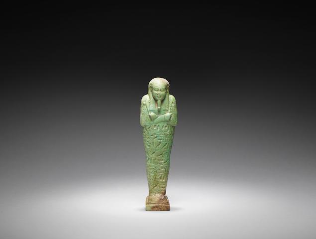 An Egyptian green glazed composition shabti
