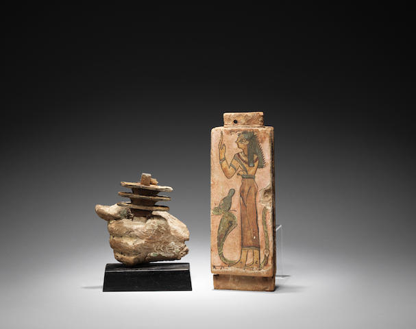 An Egyptian wood hand and a wood painted coffin section 2