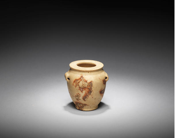 An Egyptian indurated limestone vessel