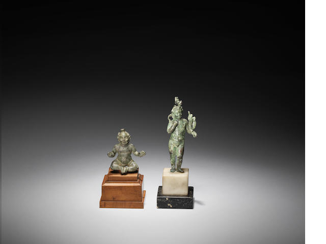 A Roman bronze figure of Harpocrates and a Roman bronze figure of the infant Harpocrates 2