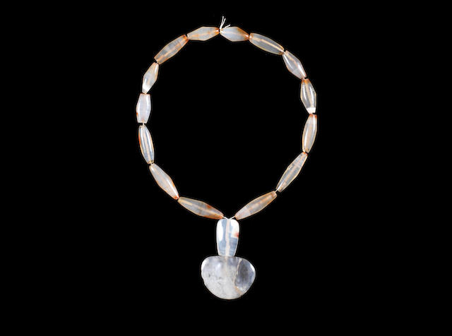 A Western Asiatic pale agate necklace