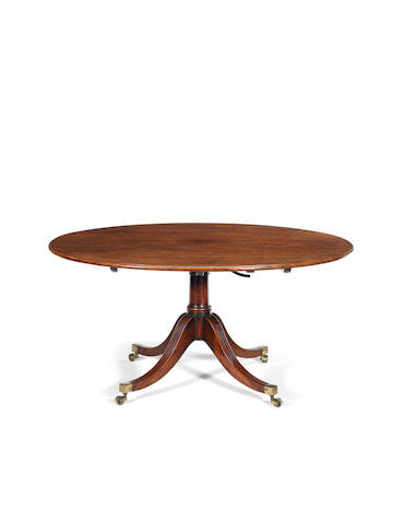 A George III mahogany oval breakfast table