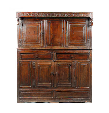 A Queen Anne oak court cupboard, dated Westmorland