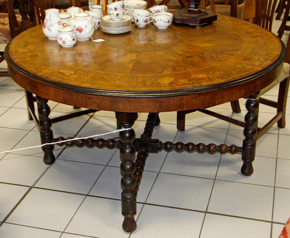 A Victorian walnut inlaid centre table,