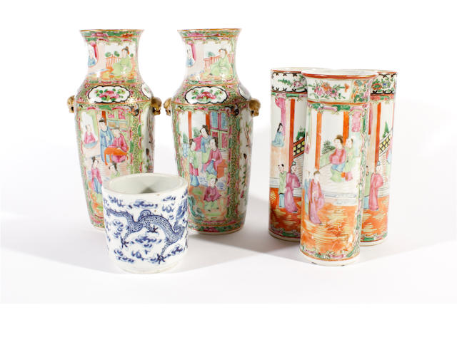 A pair of Canton Export famille rose vases, three cylindrical vases and a blue and white brush pot