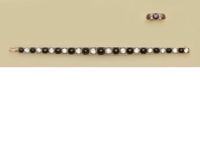 A sapphire and zircon bracelet and a ruby and diamond ring  (2)
