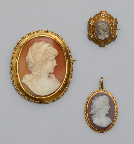 Two cameo brooches and a cameo pendant (3)