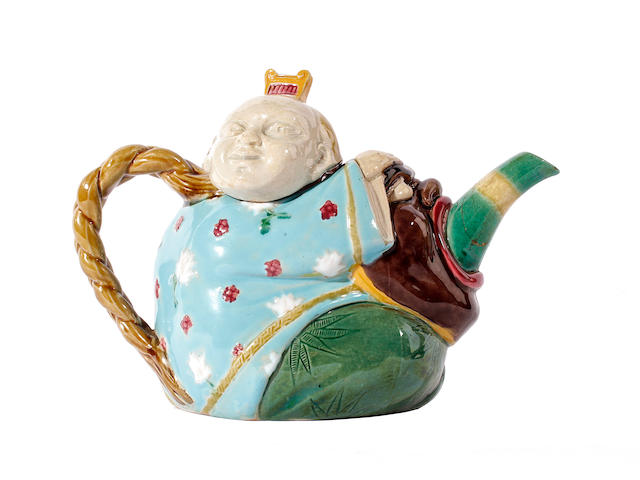 A Minton majolica chinaman teapot and cover, circa 1870