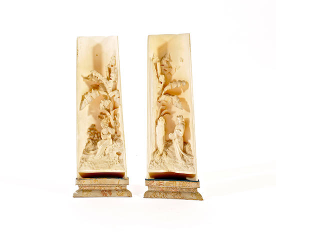 A pair of Japanese ivory carvings