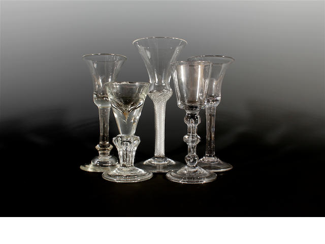 Four various wine glasses, 18th century, and another later glass