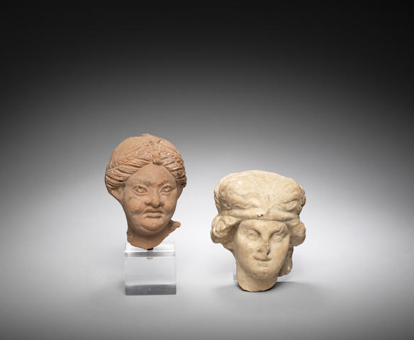 A Roman marble herm head   and a Roman terracotta head of a woman, 2