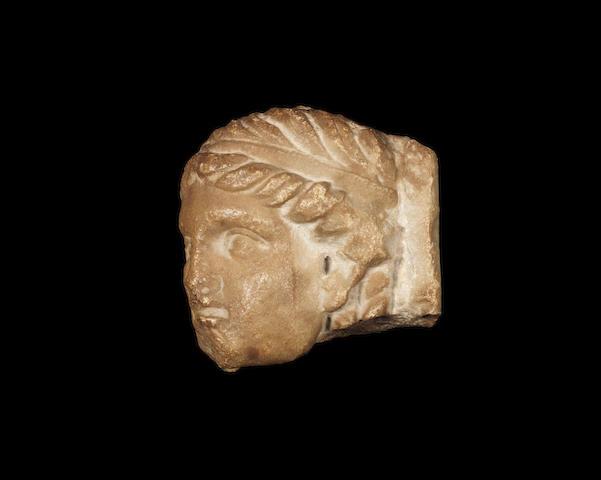 A Roman marble oscillum fragment