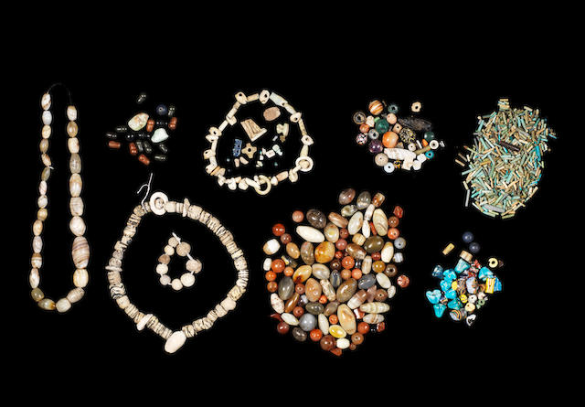 A group of hardstone, shell, glazed composition and glass beads and three fragmentary Egyptian amulets a lot