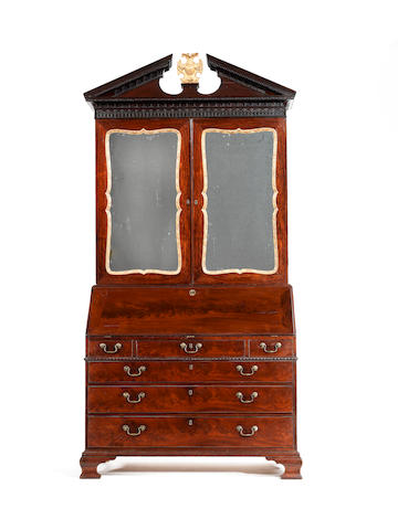 A George III mahogany and parcel gilt bureau cabinet attributed to Gillows