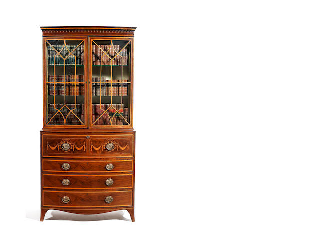 A George III mahogany, satinwood banded and marquetry bow-fronted secretaire bookcase