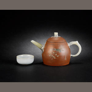 An Yixing teapot and cover Impressed four-character seal mark