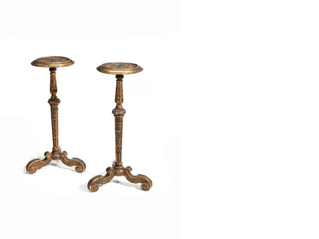A pair of George I style giltwood torcheres