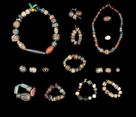 A group of glass and hardstone beads a lot