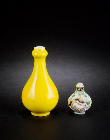 A Canton enamel style snuff bottle and a yellow monochrome vase