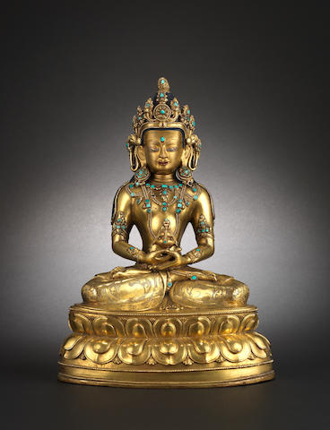 A gilded metal figure of a Buddhist Deity, probably the non Tathagata Buddha, Amitayas