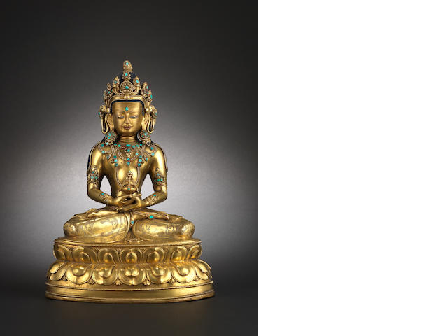 A gilt-bronze and turquoise-inset figure of Amitayus