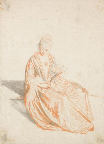 Jean Antoine Watteau (Valenciennes 1684-1721 Nogent-sur-Marne) A seated lady holding a fan