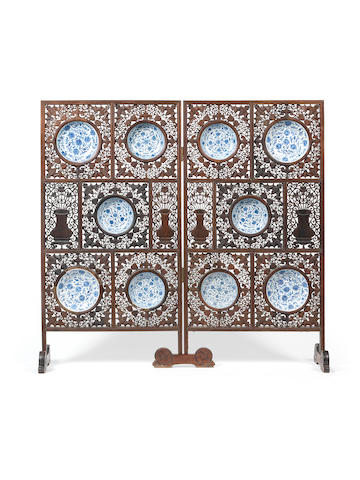 Ten blue and white dishes set within a pierced hardwood two-leaf screen The porcelain 18th/19th century