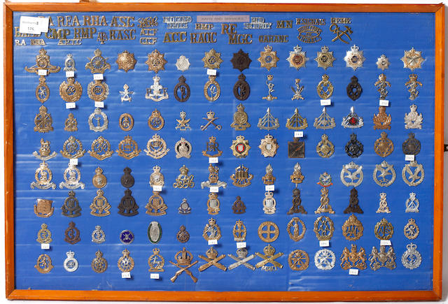 A Framed Display of Corps Cap Badges, Anodised Cap Badges Reproduction Cap Badges & Cloth Shoulder Titles