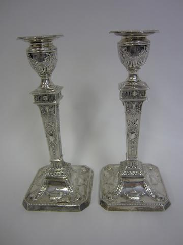 A Victorian pair of silver candlesticks, by Dixon brothers Sheffield 1899