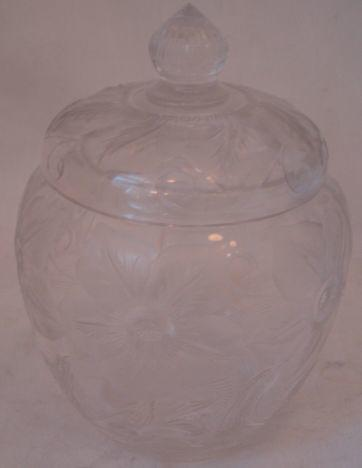 An early 20th Century Art Nouveau cut and engraved glass jar and cover,possibly Stevens & Williams, decorated with clematis flowers with scrolling stems, 21cm.