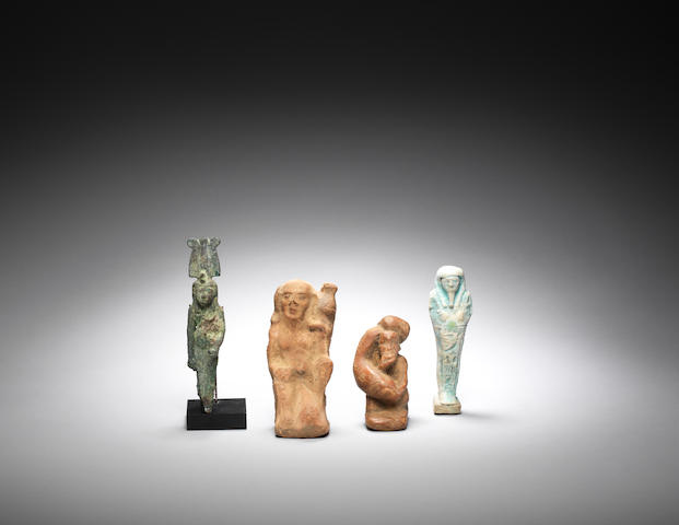 A group of four Egyptian figures 4