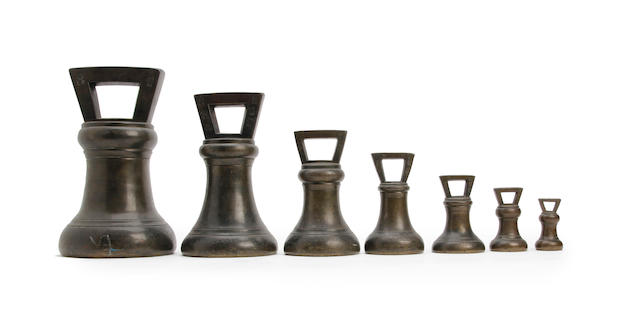A set of seven George IV bronze alloy Imperial Avoirdupois bell weights, for Carlisle, dated 1826With pre-Imperial 'WIIII 1824' verification cipher