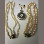 A two row pearl necklace,  (3)
