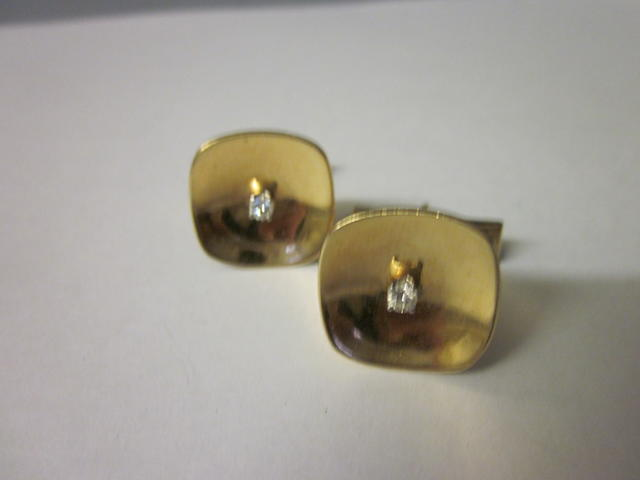A pair of diamond set cuff links,