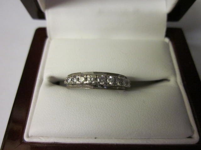 A diamond half hoop ring,