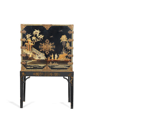 A Japanese export lacquer gilt and black cabinet on associated stand